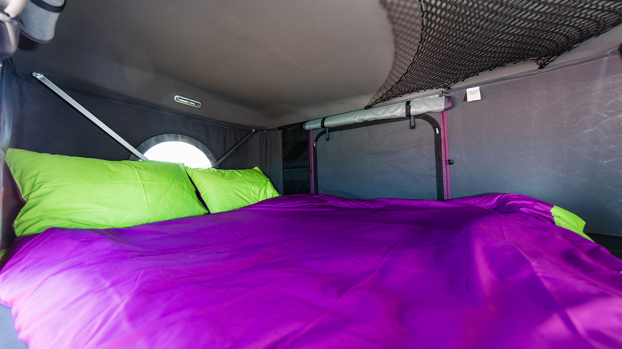 Jucy Champ Campervan Penthouse bed